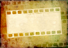 Grunge background with filmstrip. Grunge background with paper texture and filmstrips Royalty Free Stock Image