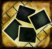 Grunge background with filmstrip and photo frames. Grunge background with filmstrip and blank photo frames Stock Photo