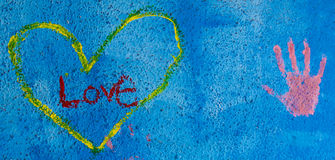 Grunge background with graffiti written Love Stock Photography