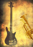 Grunge background with guitar and trumpet Stock Images
