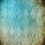 Grunge background with harlequin pattern Stock Images