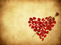 Grunge background with heart made od rose petals Royalty Free Stock Photo