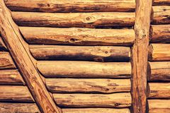 Grunge background from hewn wooden logs. Wood Log Wall Background. Wall made of hewn wooden logs royalty free stock photos