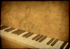 Grunge background with musical symbols Royalty Free Stock Photos