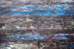 Grunge background of old brown wooden plank with bliue paint. Horizontal stripes Royalty Free Stock Photography