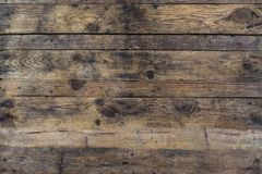 Grunge background of old brown wooden plank. Horizontal stripes royalty free stock image