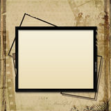 Grunge  background with old filmstrip and frame. Vintage shabby background  with old filmstrip and frame, with the space for text or photo Royalty Free Stock Photo