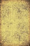 The texture of old yellow paper. Abstract grunge background. Grunge background of old paper for printing on labels, posters, business cards and creating your own Royalty Free Stock Photo