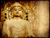 Grunge background with old paper texture and Buddha's statue Royalty Free Stock Image