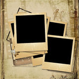 Grunge  background with old polaroid-frames. Vintage shabby photo-album with polaroid-frame and with the space for text or photo Stock Photos
