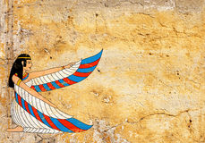 Grunge background with old stucco texture and Egyptian goddess I Stock Photos