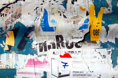 Grunge Background with Old Torn Posters Royalty Free Stock Photo