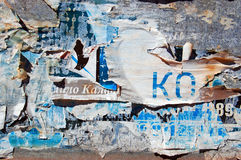 Grunge Background with Old Torn Posters Royalty Free Stock Photos