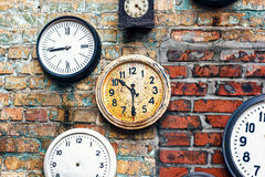 Grunge background with old watch. Time concept. Retro clocks on the wall. Old antique clock on aged red brick wall background. Vintage clocks royalty free stock image