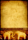 Grunge background with paper texture and carving famous elephant Royalty Free Stock Photo