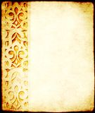 Grunge background with paper texture and ornament in Moroccan style. Grunge background with paper texture and detail of an ancient carved floral stone ornament royalty free stock images