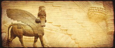 Grunge background with paper texture and lamassu. Human-headed winged bull statue, Assyrian protective deity. Copy space for text. Mock up template royalty free stock images
