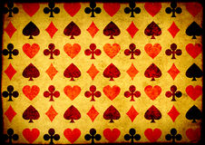 Grunge background with paper texture and playing cards symbol. Horizontal grunge background with paper texture and playing cards symbols Stock Image