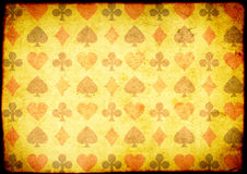 Grunge background with paper texture and playing cards symbol Royalty Free Stock Images