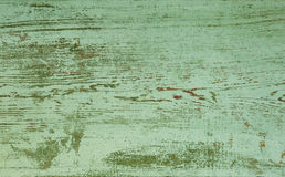 Grunge background. Peeling paint on an old wooden board royalty free stock photography