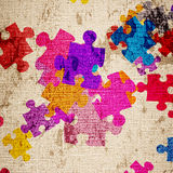 Grunge background with puzzles Stock Photography