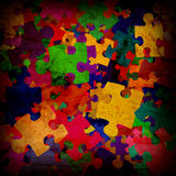 Grunge background with puzzles Stock Photos