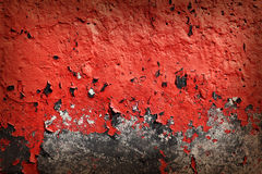 Grunge background with red cracked paint Royalty Free Stock Photos