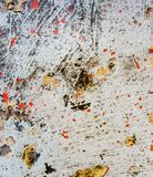 Grunge background with red and yellow paint splash. Great grunge texture. Grunge texture with color splash paint on the wall. Useful as grunge backdrop. Horror stock photos