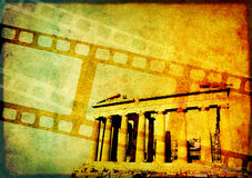 Grunge background with retro filmstrips and paper texture. Grunge background with retro filmstrips, famous landmark of Athens - Parthenon, and old paper texture Royalty Free Stock Photo