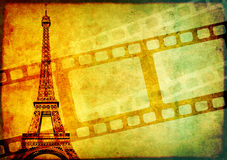 Grunge background with retro filmstrips and paper texture. Grunge background with retro filmstrips, famous landmark of Paris - Eiffel Tower, and old paper Royalty Free Stock Photo