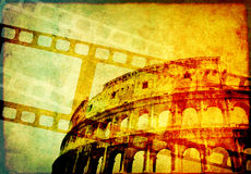 Grunge background with retro filmstrips and paper texture. Grunge background with retro filmstrips, famous landmark of Rome - Colosseum, and old paper texture Royalty Free Stock Image