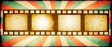 Grunge background with retro filmstrips and paper texture. Grunge horizontal background with retro filmstrips and old paper texture with striped brust pattern Royalty Free Stock Photography