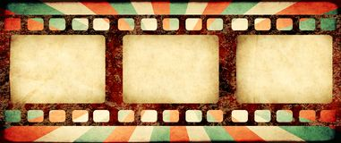 Grunge background with retro filmstrips and paper texture. Grunge horizontal background with retro filmstrips and old paper texture with striped brust pattern Stock Image