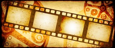 Grunge background with retro filmstrips and paper texture. Grunge horizontal background in steampunk style with retro filmstrips and old paper texture. Mock up Stock Image
