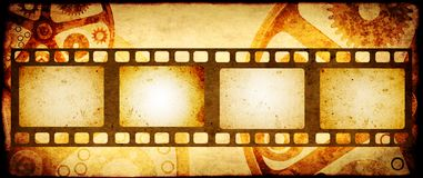 Grunge background with retro filmstrips and paper texture. Grunge horizontal background in steampunk style with retro filmstrips and old paper texture. Mock up Royalty Free Stock Image
