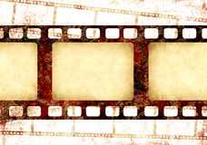 Grunge background with retro filmstrips and paper texture. Grunge background with retro filmstrips and old paper texture Stock Photography