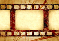 Grunge background with retro filmstrips and paper texture. Grunge background with retro filmstrips and old paper texture Stock Images