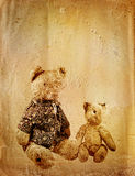 Grunge background with retro toy bears Stock Images