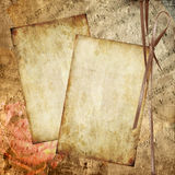 Grunge background with rose and note Stock Photos