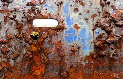 Grunge background of rusting painted iron. Rusted and very corroded painted metal from a wrecked fishing boat for grunge backgrounds Royalty Free Stock Photo