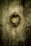 Grunge background - rusty antique door knocker Stock Image