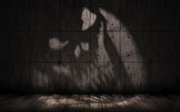 Grunge background with shadow in the shape of a skull Royalty Free Stock Image