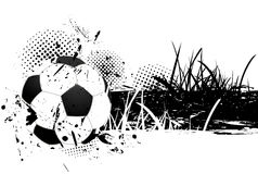 Grunge background with soccer ball. And grass Stock Images