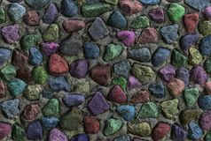 Grunge background stones wall multicolor red blue lilac print pattern Stock Images