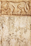 Grunge background with stucco texture and bas-relief carving of Stock Photos