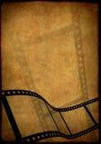 Grunge background - symbolical image of a film. Grunge background - symbolical the image of a film Royalty Free Stock Image