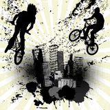 Grunge background with two bikers and city skyline Stock Photos