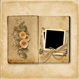 Grunge background with vintage album with roses stock photography
