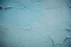 Grunge Background. Wall with the colored whitewash falling off fragment as a background texture cracked Royalty Free Stock Photo