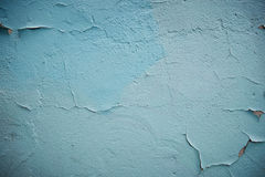 Grunge Background. Wall with the colored whitewash falling off fragment as a background texture cracked Stock Image